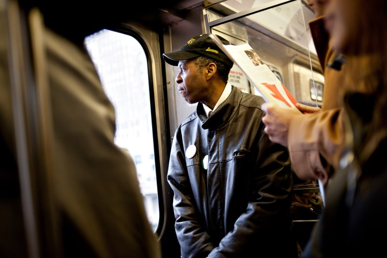Tyree Johnson, a 20-year McDonald's employee making minimum wage, rides a train on his way to work in Chicago, Illinois, U.S., on Nov. 26, 2012.