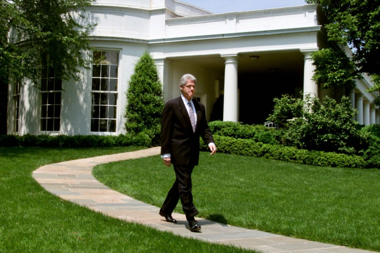 U.S. President Bill Clinton walks out of the Oval Office at the White House on his way to make a statement about the economy, May 5, 2000.