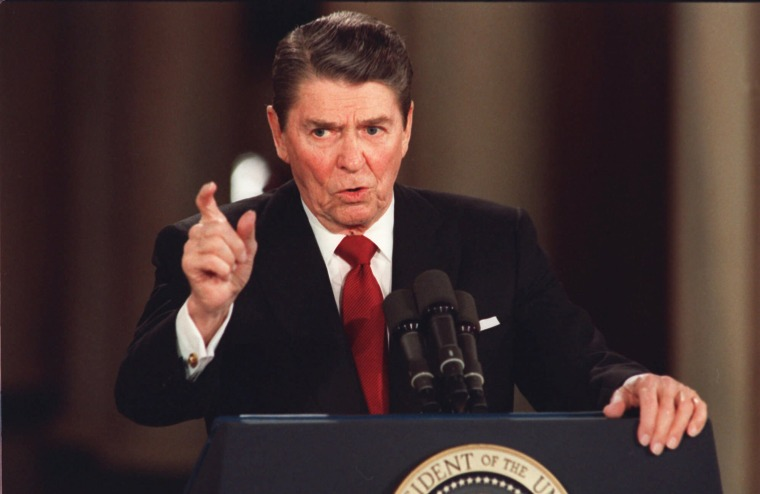 In this March 19, 1987 file photo, President Reagan gestures during a news conference at the White House in Washington.