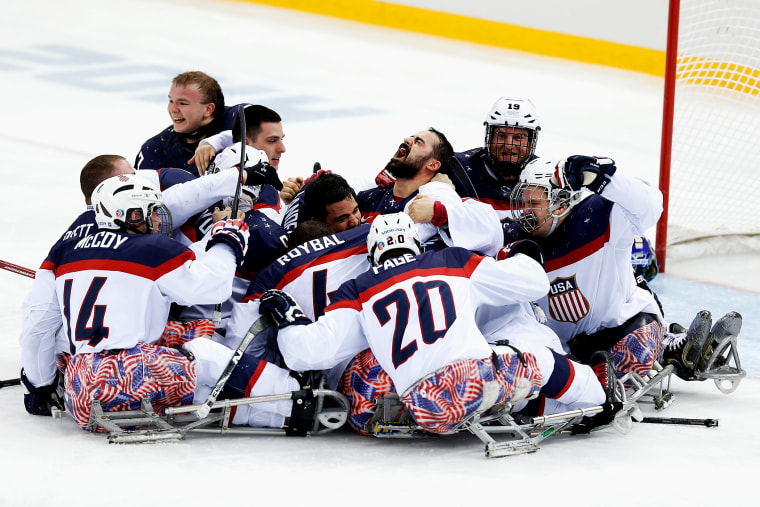 Team USA celebrates winning the Ice Sledge Hockey Gold Medal match between Russia and USA at the Shayba Arena during day eight of the 2014 Paralympic Winter Games on March 15, 2014 in Sochi, Russia.
