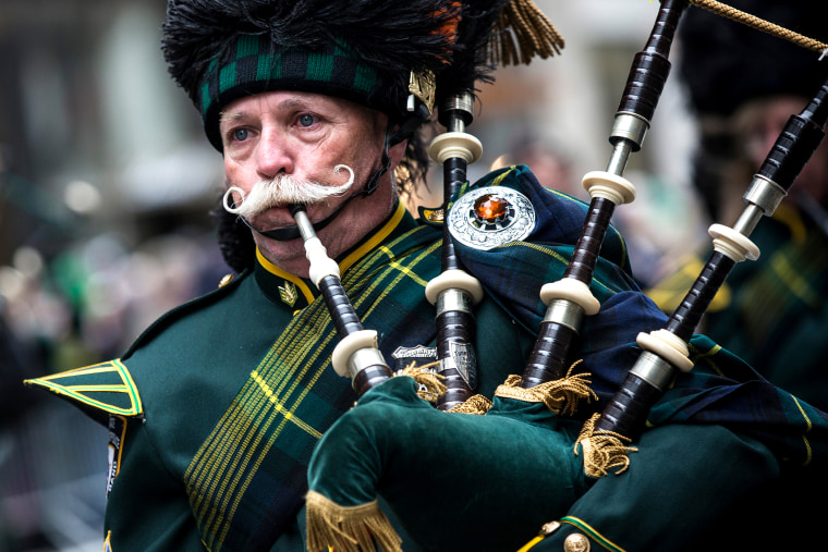 A bagpiper marches in the annual St. Patrick's Day Parade along Fifth Ave in Manhattan on March 17, 2014 in New York, NY.