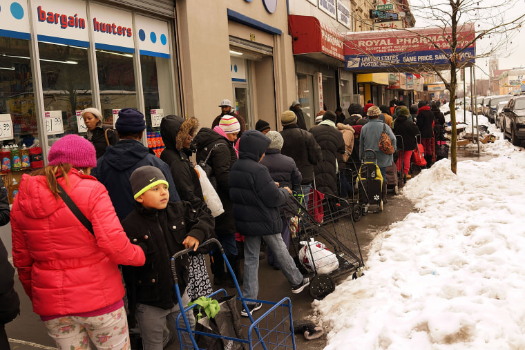 People wait in line for CAMBA's Beyond Hunger Emergency Food Pantry on February 18, 2014 in the Brooklyn borough of New York City.