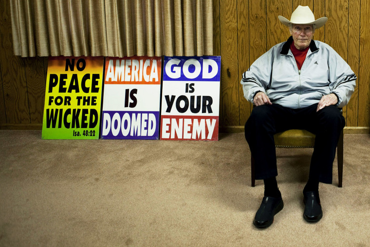 Fred W. Phelps Sr., of Westboro Baptist Church, pictured with picket signs at Westboro Church in Topeka, Kansas, Sept. 8, 2010.