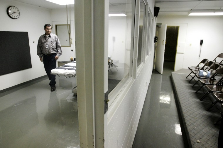 In this April 15, 2008, file photo a wardens assistant at the Oklahoma State Penitentiary, walks past the gurney in the execution chamber at left, in McAlester, Okla..