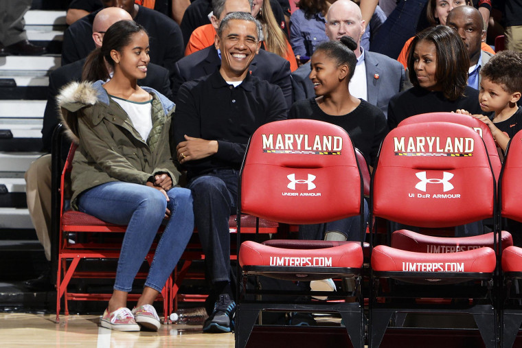 President Obama and his family watch a college basketball game between the Oregon State Beavers and the Maryland Terrapins, Nov. 17, 2013.