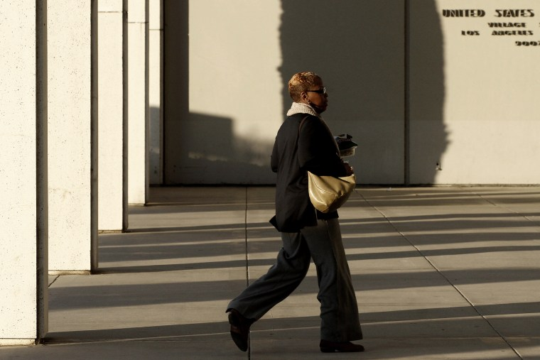 An employee arrives at the Federal Building in Los Angeles