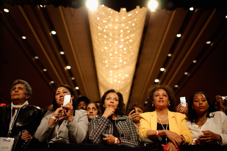 Supporters listen to U.S. President Barack Obama as he addresses the Women's Leadership Forum at the Grand Hyatt Hotel May 19, 2011 in Washington, DC.