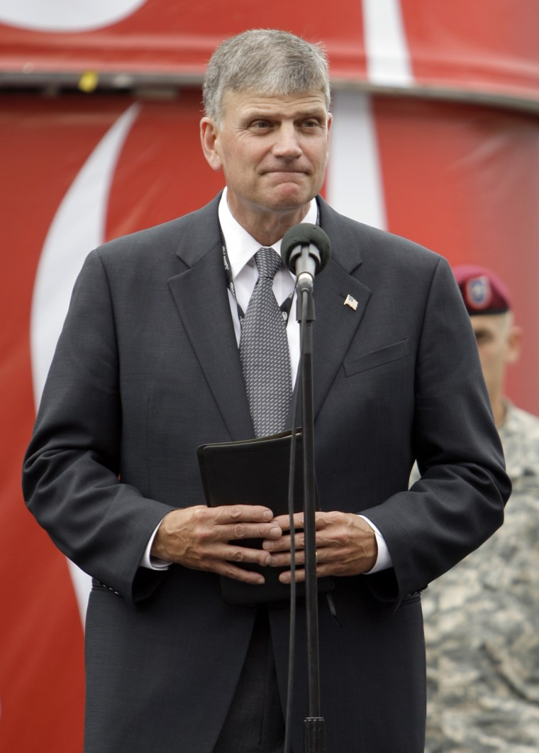 Franklin Graham prepares to give the invocation before the NASCAR Coca-Cola 600 auto race at Lowe's Motor Speedway in Concord, N.C., May 24, 2009.