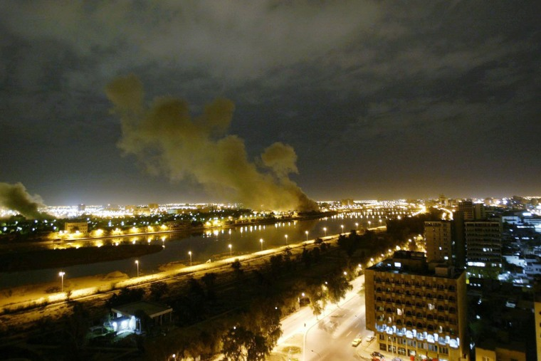 Smoke rises from the Trade Ministry in Baghdad on March 20, 2003 after it was hit by a missile during the US-led forces attack, marking the start of the invasion of Iraq.