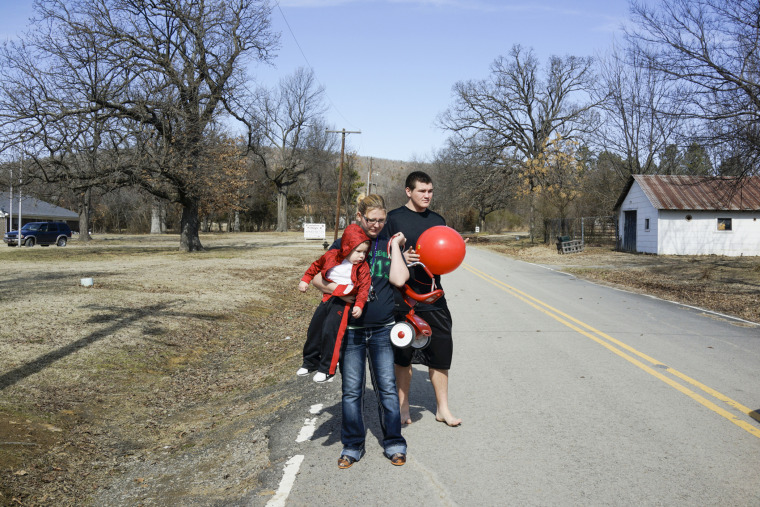 Autumn and Mike Sisco with their son Bobby in Quinton, Okla. Autumn and Mike had their son when she was 17 and he was 15.