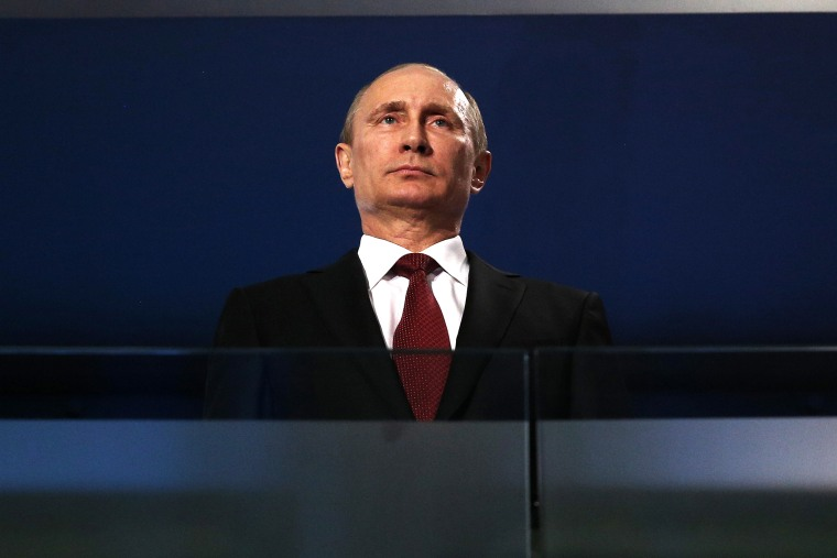 Russian President Vladimir Putin watches the Sochi 2014 Paralympic Winter Games Closing Ceremony, March 16, 2014 in Sochi, Russia.