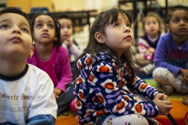 Students quietly listen in art class at Campbell Elementary School, in Arlington, VA, Jan. 14, 2014.
