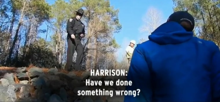 In North Carolina, a deputy with the Chatham County Sheriff's Department tells environmental activists to leave the canal they've come to inspect.