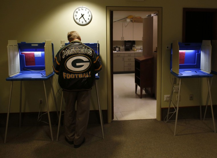 Voters cast their vote in the Presidential elections on November, 6, 2012 in Janesville, Wisconsin.
