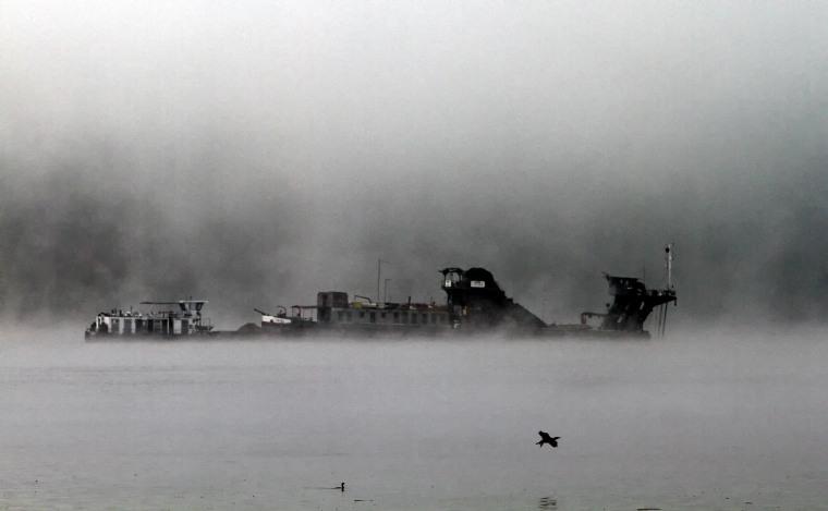 A ship on a foggy morning.