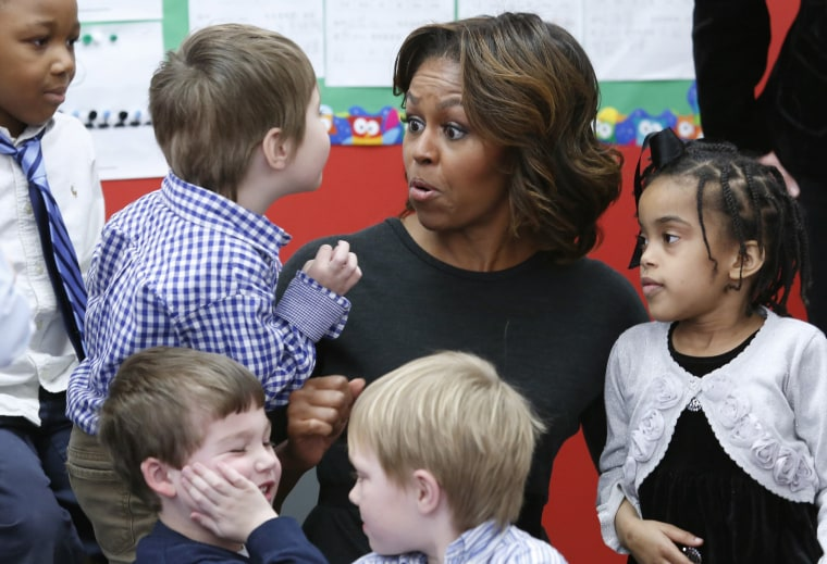 First lady Michelle Obama meets pre-school students in Washington, March 4, 2014.