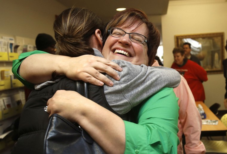 Plaintiff April Deboer celebrates after a Michigan federal judge ruled that a ban on same-sex marriage violates the U.S. Constitution and must be overturned, in Ferndale, Michigan March 21, 2014.