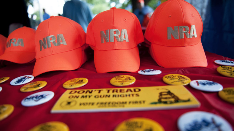 National Rifle Association (NRA) items are displayed at the NRA booth on the grounds of the Iowa straw poll in Ames, Iowa, August 13, 2011.