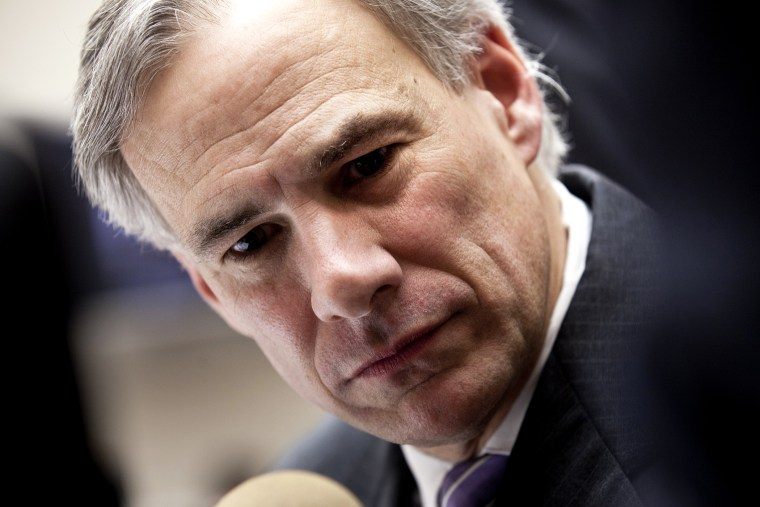 Texas Attorney General Greg Abbott speaks to reporters during a break in a hearing, Feb. 9, 2011, on Capitol Hill in Washington, DC.