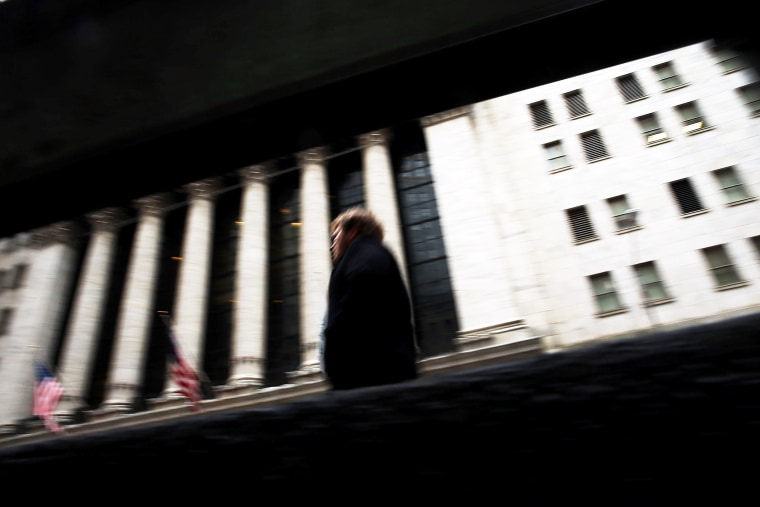 A person walks by the New York Stock Exchange on Jan. 27, 2014 in New York City.