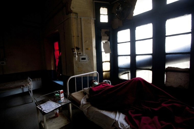 A tuberculosis patient Abdul Rasheed lies on a bed in an isolated ward at the Chest Disease Hospital on World Tuberculosis Day in Srinagar, India, March 24, 2012.