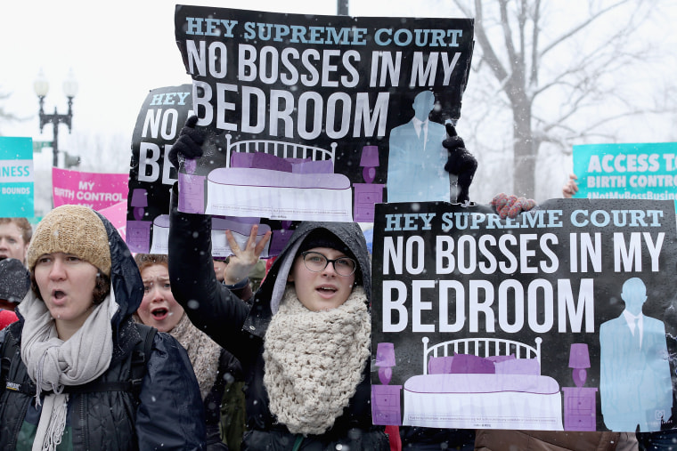 Demonstrators rally outside of the U.S. Supreme Court during oral arguments in Sebelius v. Hobby Lobby March 25, 2014 in Washington, DC.