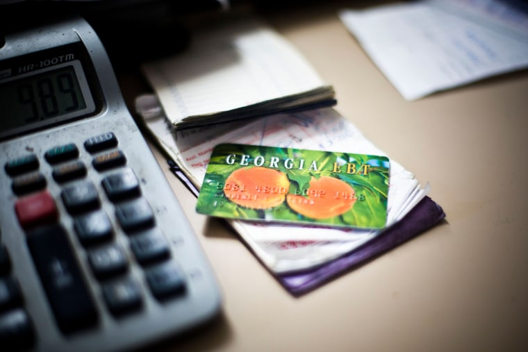 An electronic benefit card for Georgia's food stamp program sits on the counter of Shinholster Grocery & Meat in Irwinton, Ga., Nov. 21, 2013.