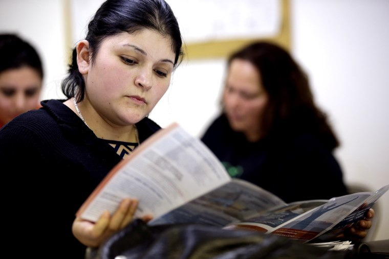 Sara Rodriguez looks over an Affordable Care Act brochure, in Houston on March 11, 2014.