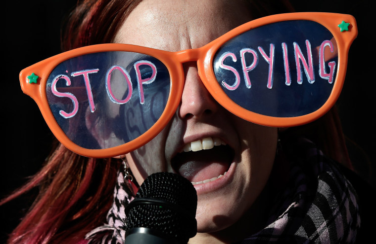 Alli McCracken joins activists protesting the surveillance of U.S. citizens by the NSA outside the Justice Department, January 17, 2014 in Washington, D.C.