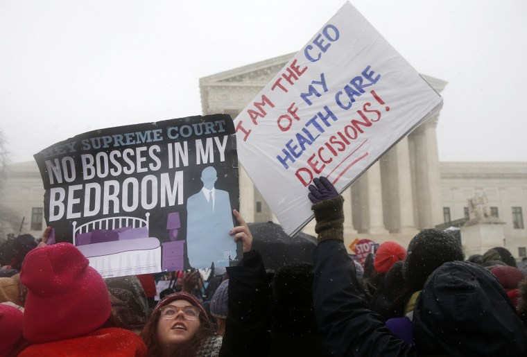 Demonstrators gather in front of the Supreme Court in Washington, Tuesday, March 25, 2014.