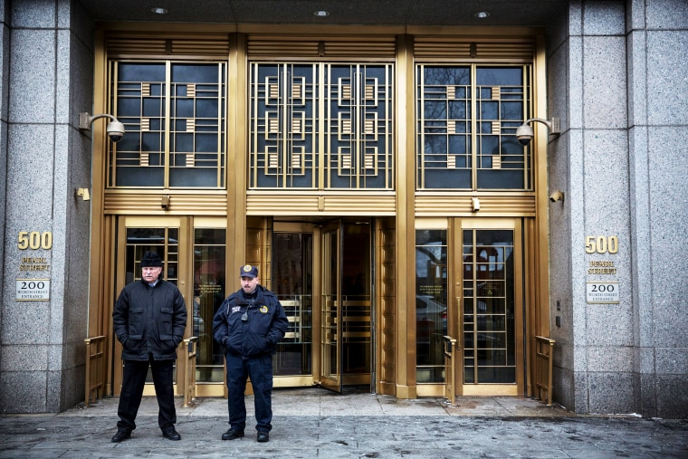 Security guards stand outside Federal Court as the trial for Osama Bin Laden's son-in-law, Sulaiman Abu Ghaith, begins in New York City, Mar. 3, 2014.