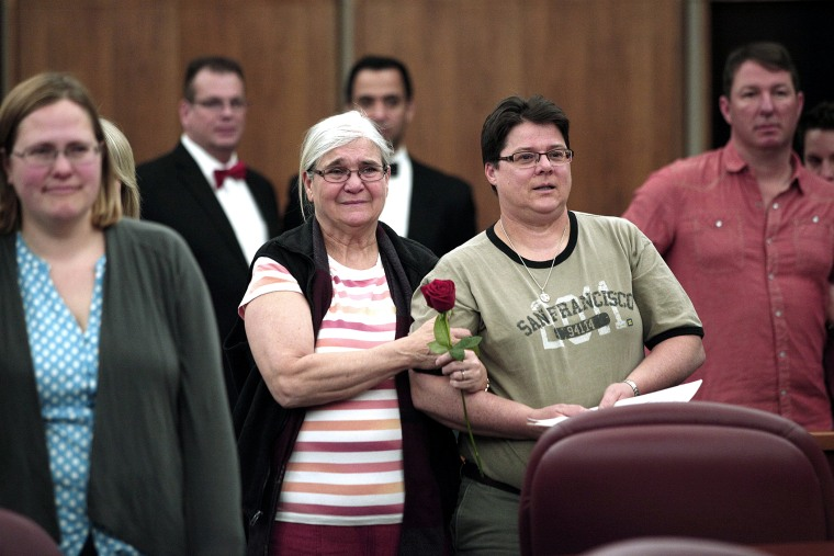 Same-sex couples get married in a group ceremony at the Oakland County Courthouse on March 22, 2014 in Pontiac, Mich.