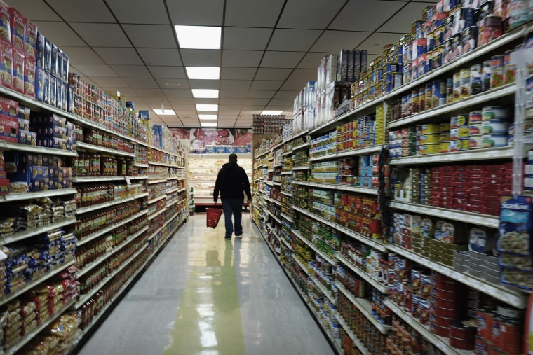 A man walks through a grocery store in Bridgeport, Connecticut.
