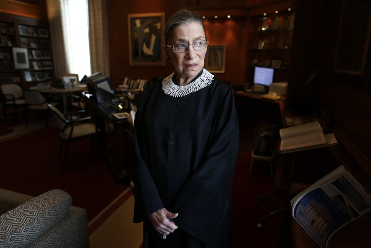 Associate Justice Ruth Bader Ginsburg poses for a photo in her chambers at the Supreme Court in Washington, on July 24, 2013,