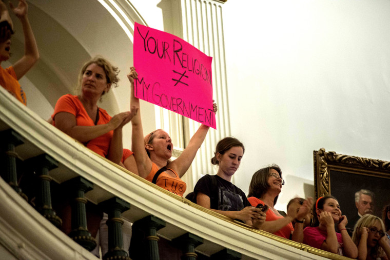 Demonstrators protest at State Capitol building in Austin, Texas, on July 12, 2013.