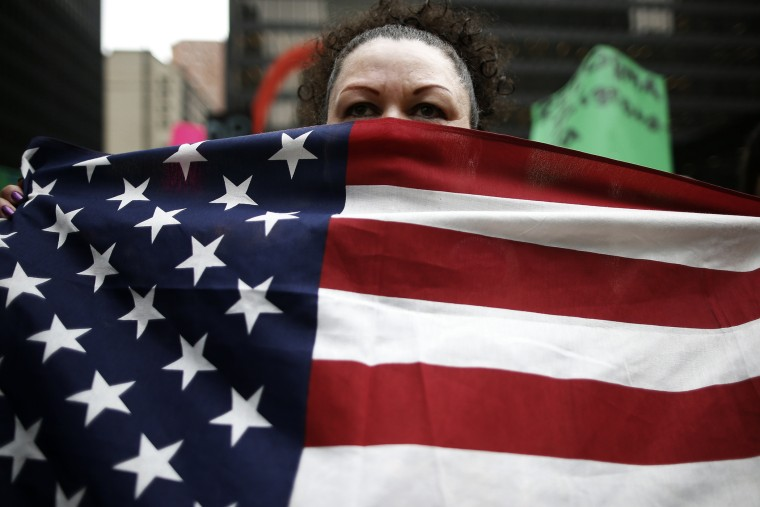 A protester takes part in a demonstration calling for immigration reform at a rally in Chicago, Ill. on March 27, 2014.