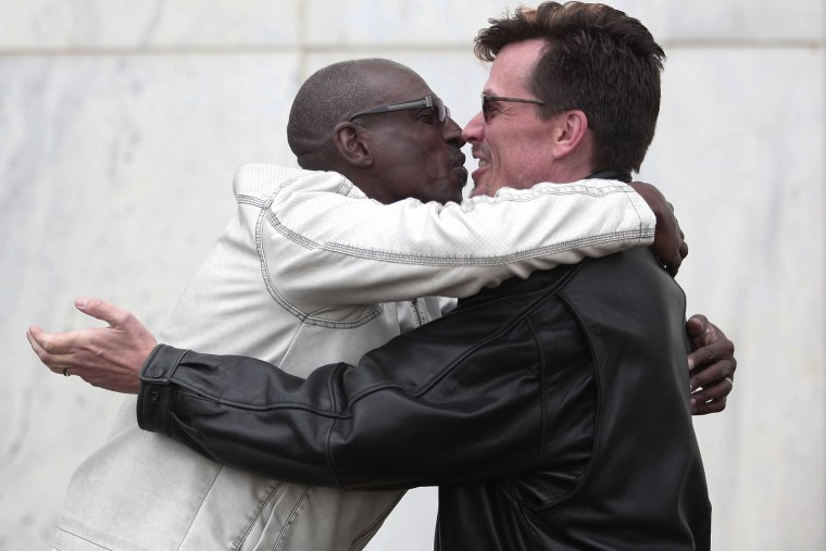 Roland Smith (L) and Paul Mattson (R) of Farmington Hills, MI., kiss after getting married at the Oakland County Courthouse on March 22, 2014 in Pontiac, Mich.