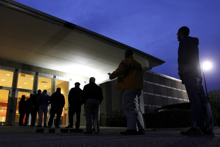 Voters stand in line before the sun rises to cast their votes at a polling precinct at the Wake County Firearms Education and Training Center in Apex, N.C., on Election Day, Nov. 6, 2012.