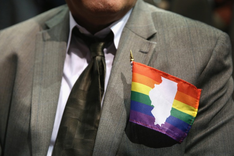 A supporter of gay marriage wears an Illinois gay pride flag on his jacket on Nov. 20, 2013 in Chicago, Ill.