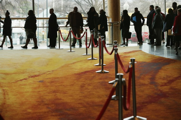 About 1,500 people seeking employment wait in line to enter a job fair, March 28, 2014 in Washington, DC.