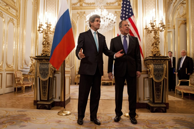 US Secretary of State John Kerry (L) gestures next to Russian Foreign Minister Sergey Lavrov (R) at the Russian Ambassador's Residence in Paris, March 30, 2014.