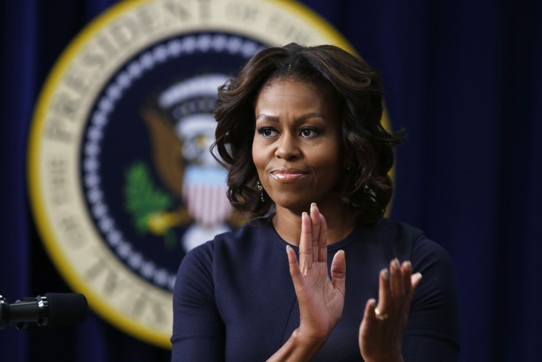 First lady Michelle Obama applauds as she gives remarks during an event, Jan. 16, 2014, in Washington, D.C.