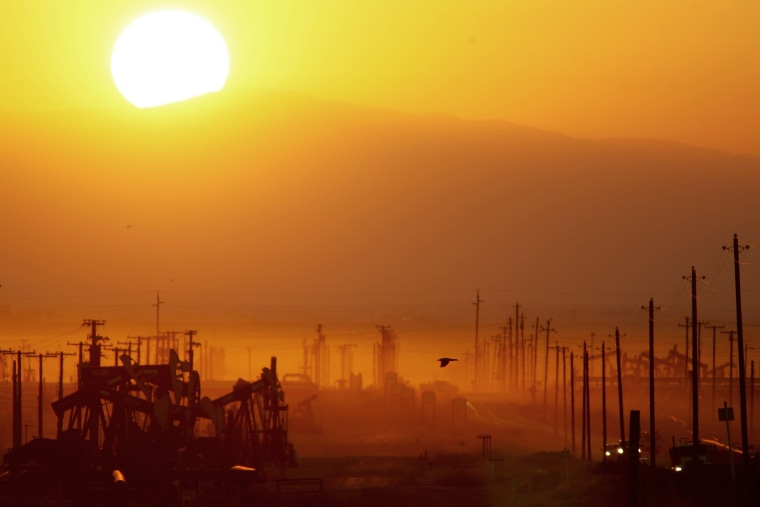 The sun rises over an oil field over the Monterey Shale formation on March 24, 2014 near Lost Hills, Calif.