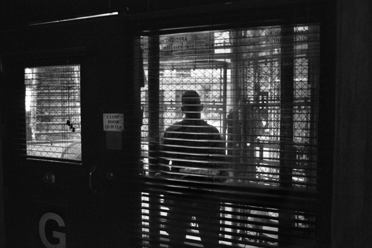 Views through the fenced-in guard post into the common area of a cell block in Camp 6 of the U.S. Naval Base and detention center in Guantanamo Bay, Cuba.