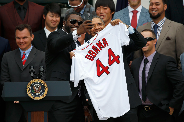 """Boston Red Sox designated hitter David Ortiz poses for a """"selfie"""" with U.S. President Barack Obama on the South Lawn of the White House on April 1, 2014 in Washington, DC."""