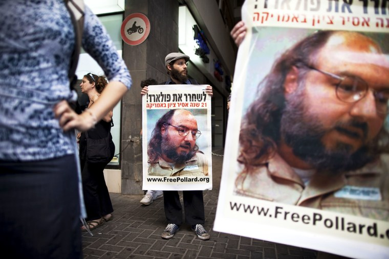 Israeli protesters hold posters demanding the release of Jonathan Pollard.