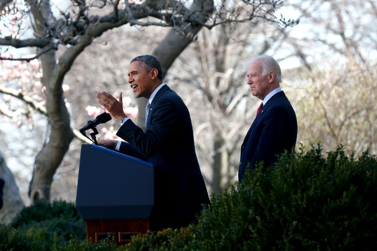 U.S. President Barack Obama (C) speaks about the Affordable Care Act as U.S. Vice President Joe Biden (R) watches in the Rose Garden of the White House on April 1, 2014 in Washington, DC.