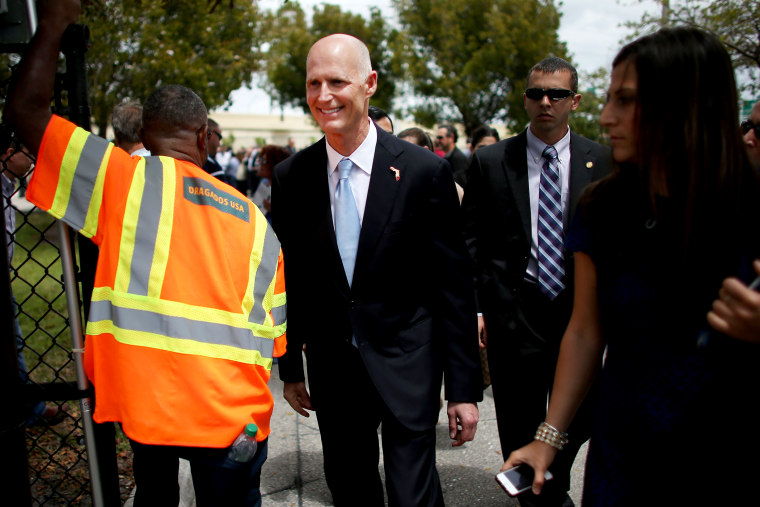 Florida Governor Rick Scott attends the ribbon cutting for the opening of a I-595 Express Project in Davie, Fla., Mar. 28, 2014.