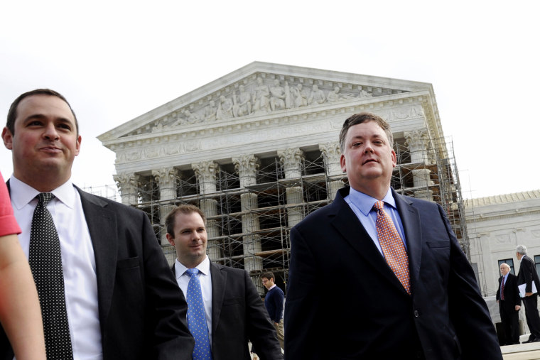 Shaun McCutcheon (R) leaves the Supreme Court in Washington, Tuesday, Oct. 8, 2013, after the court's hearing on campaign finance.