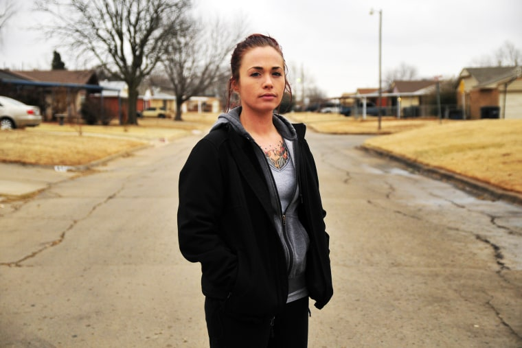 Tina Wilson, who was a victim of sexual assault while serving in the Navy, outside of her brothers home in Del City, OK.